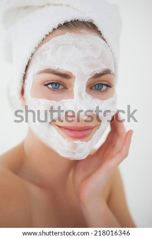 Beautiful blonde getting a facial treatment at the health spa - stock photo