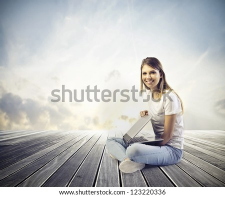 Beautiful blonde girl closing laptop - stock photo