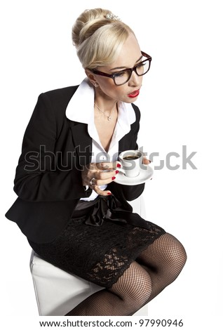 Beautiful blonde girl drink coffee on a white background - stock photo