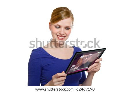 beautiful blonde girl holding a tablet pc und uses the video chat