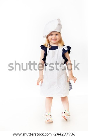 Beautiful blonde girl in costume of cook standing on white backg - stock photo