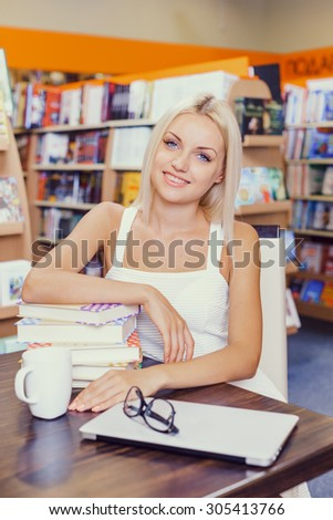 Beautiful blonde girl in library