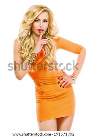 Beautiful blonde girl in red dress with perfect skin, slender figure, the finger near the mouth, in secret, isolated on a white background - stock photo