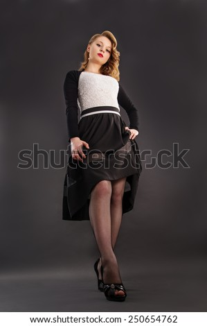 Beautiful blonde girl in the studio on a black background