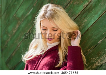 beautiful blonde girl  posing with red lips on the street the wind in your hair sun street fashion clothing - stock photo