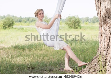 beautiful blonde girl resting on the nature - stock photo