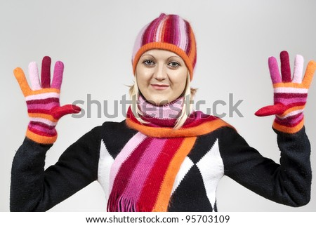 Beautiful blonde girl wearing a hat on a background - stock photo