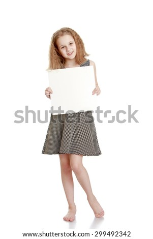 Beautiful blonde girl with haircut caret in a gray silk dress with no shoes holding before him a square sheet of cardboard on which you can write ads-Isolated on white background - stock photo