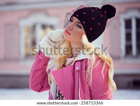 Beautiful blonde girl with makeup outdoors - stock photo