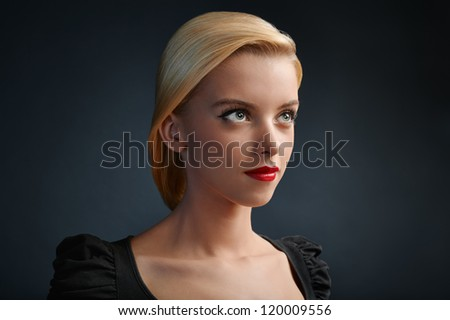 Beautiful blonde girl with red lips and modern haircut