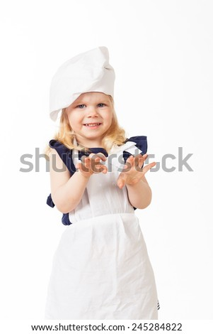 Beautiful blonde hair girl in costume of cook on white background - stock photo