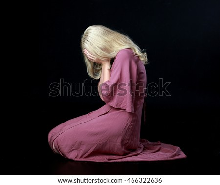 http://thumb9.shutterstock.com/display_pic_with_logo/3644120/466322636/stock-photo-beautiful-blonde-haired-woman-wearing-a-long-flowing-purple-dress-kneeling-on-the-ground-466322636.jpg