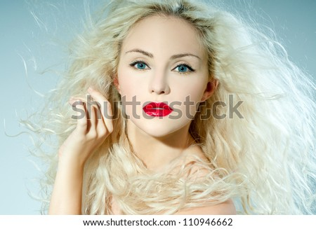 beautiful blonde, heavily made up red lipstick - stock photo