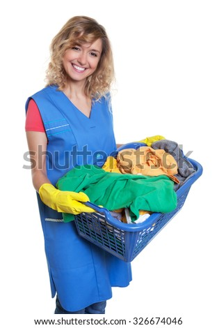 Beautiful blonde housewife with dirty clothes - stock photo