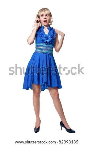 Beautiful blonde in a blue dress with phone isolated on white
