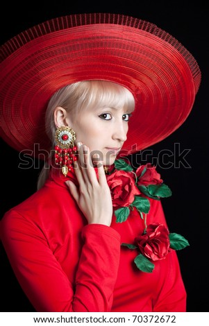 beautiful blonde in a red hat on a black background with flowers - stock photo