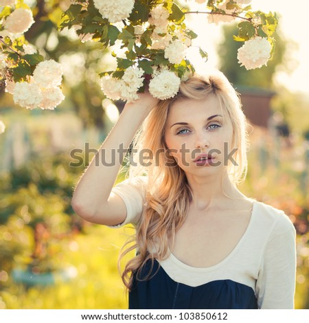 beautiful blonde in a spring garden - stock photo