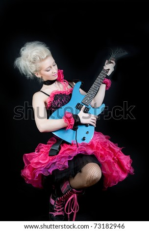 beautiful blonde in black and pink dress with an electric guitar - stock photo