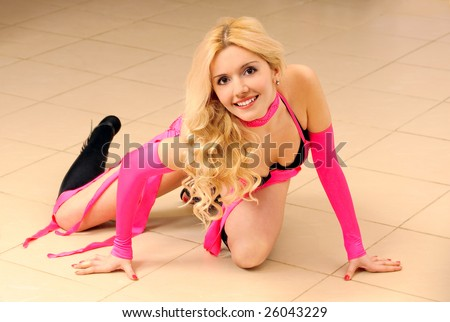 Beautiful blonde in dancing suit on floor. - stock photo