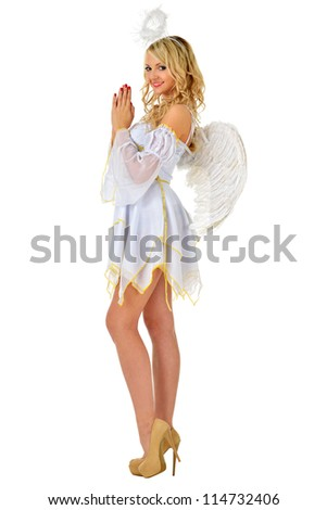 Beautiful blonde in fancy dress costume of angel. Isolated image. - stock photo
