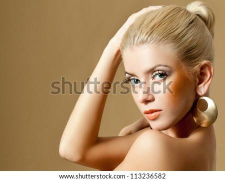 beautiful blonde in gold earrings - stock photo