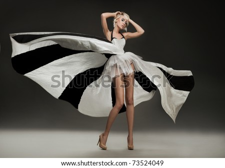 Beautiful blonde in marvelous dress - stock photo
