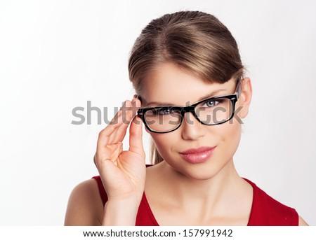 Beautiful blonde in stylish eyewear posing in studio. Young attractive Caucasian business woman wearing optical glasses.    - stock photo