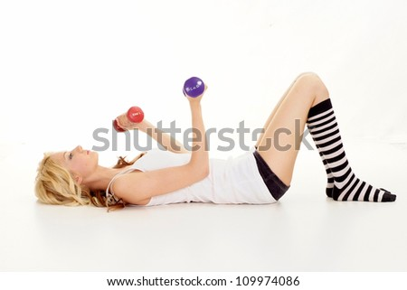 Beautiful blonde is doing sports exercises and resting on a white background