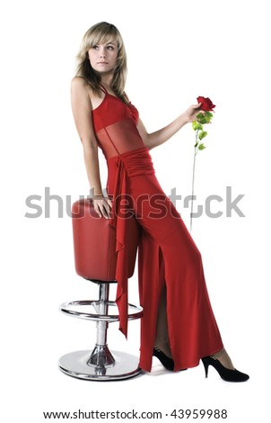 Beautiful blonde lady in a red dress - stock photo
