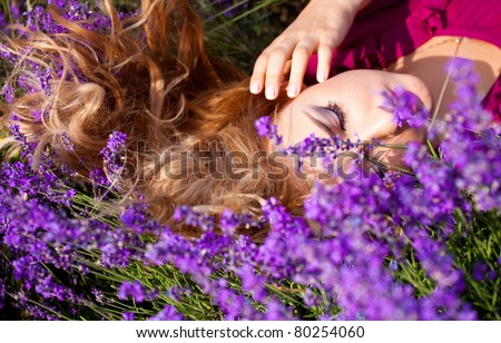 beautiful blonde laying in lavender field