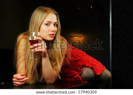 Beautiful blonde lying on a bar counter. - stock photo