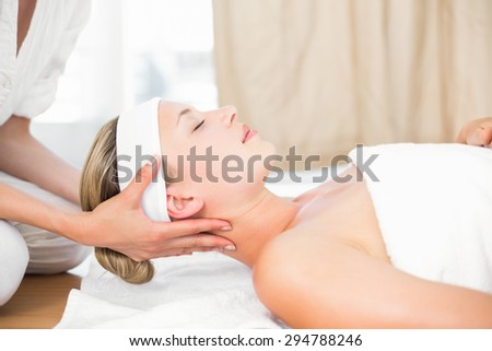 Beautiful blonde lying on massage table at the health spa - stock photo