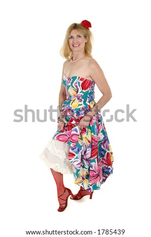 Beautiful blonde middle aged woman shows her Can Can legs with mesh stockings & flower in her hair. - stock photo