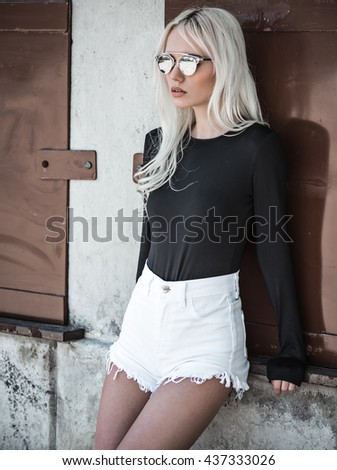 Beautiful blonde model in posing - stock photo