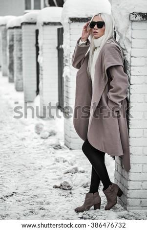 Beautiful blonde model in posing outdoors - stock photo