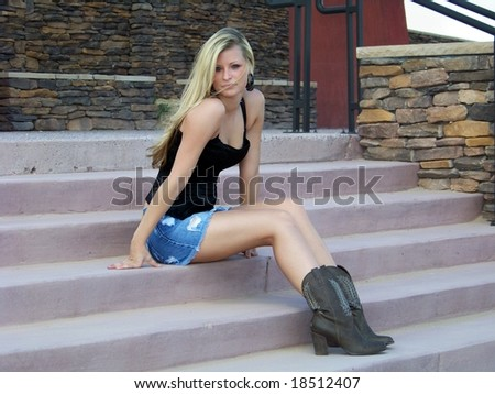 beautiful blonde model posing outside for fashion and beauty shoot.