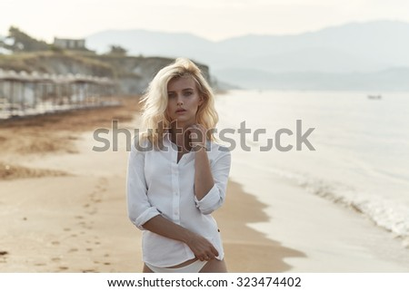 Beautiful blonde on the beach - stock photo