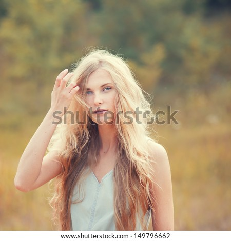 beautiful blonde outdoors - stock photo