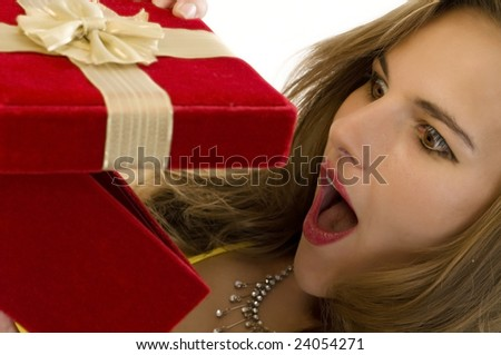Beautiful Blonde Overjoyed by her Surprise Gift. (Shallow DOF) - stock photo