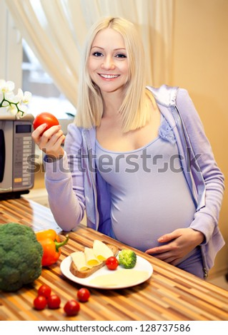 beautiful blonde pregnant and healthy food