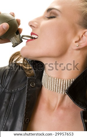Beautiful Blonde pulling a Hand Grenade Pin with her Teeth. - stock photo