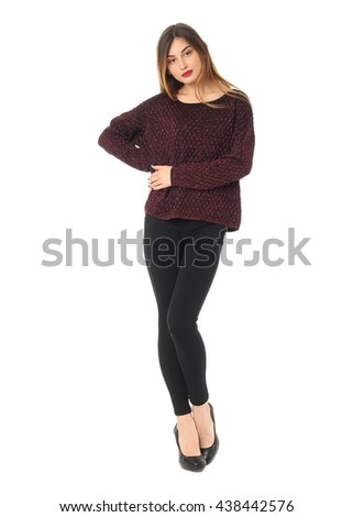 Beautiful blonde teenager in black leggings isolated on white
