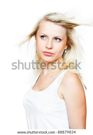 Beautiful blonde with a flying hair. Isolated on white background - stock photo