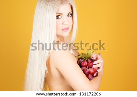 Beautiful blonde with grapes