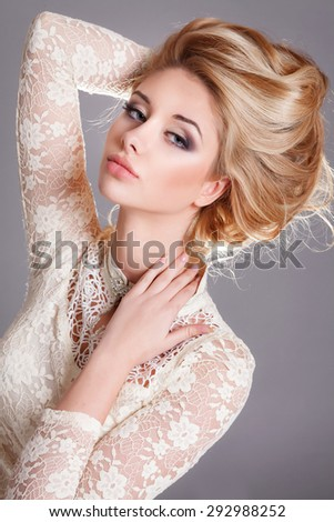 Beautiful blonde woman beauty model girl with long curly hair bright makeup, Fashion young woman face, Beauty girl with blond wavy long hair, Beautiful model girl with healthy hair, isolated studio - stock photo