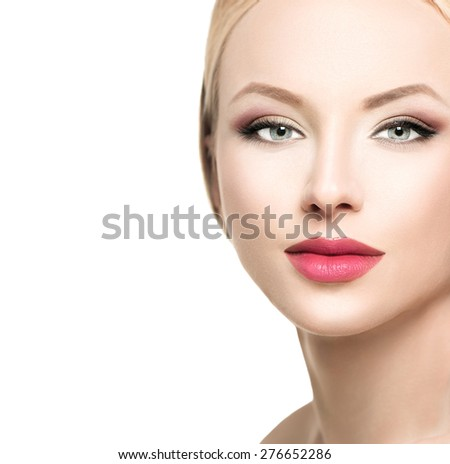 Beautiful blonde woman face close up. Portrait of fashion model with clean skin, bright makeup. Isolated on white background. Beauty female. Skincare. Perfect make up - stock photo