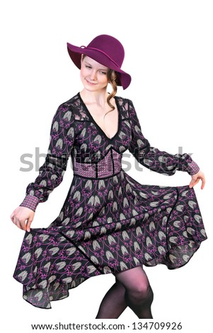 Beautiful blonde woman gracefully dancing in a dress and a hat on white background - stock photo