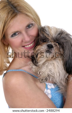 Beautiful blonde woman holding Shih Tzu dog.