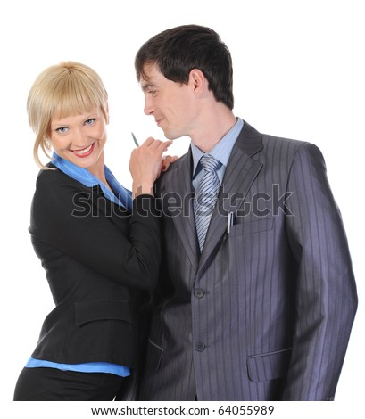 Beautiful blonde woman hugging a man in the suit. Isolated on white background - stock photo