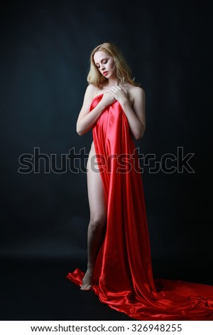 https://thumb9.shutterstock.com/display_pic_with_logo/3644120/326948255/stock-photo-beautiful-blonde-woman-in-long-flowing-red-silk-dress-dark-background-326948255.jpg